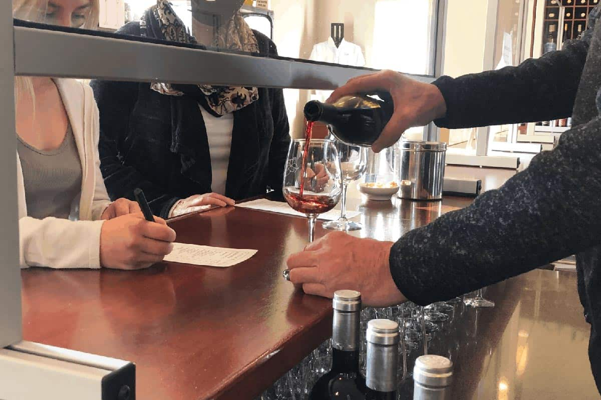 Pouring wine at the Tasting Room at Villa Bellezza